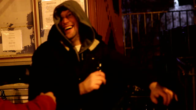 two drunk men with beer outdoors at cold winter night - moving down stock videos & royalty-free footage