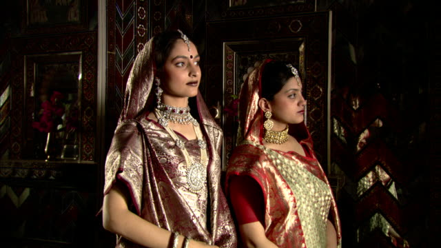two east indian women wear an assortment of gold and silver jewelry. - hinduism stock videos & royalty-free footage