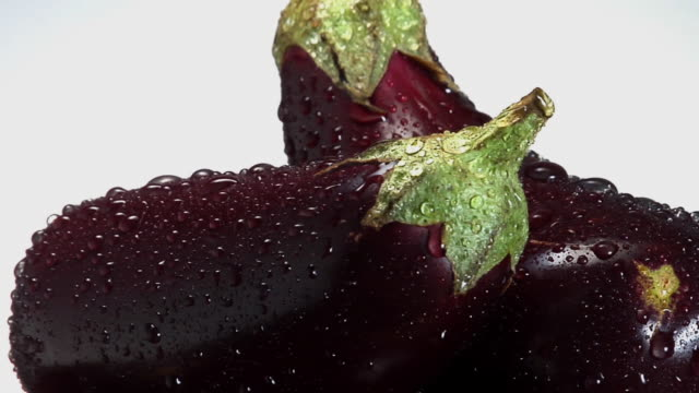 cu, two eggplants with water droplets rotating - aubergine stock videos & royalty-free footage