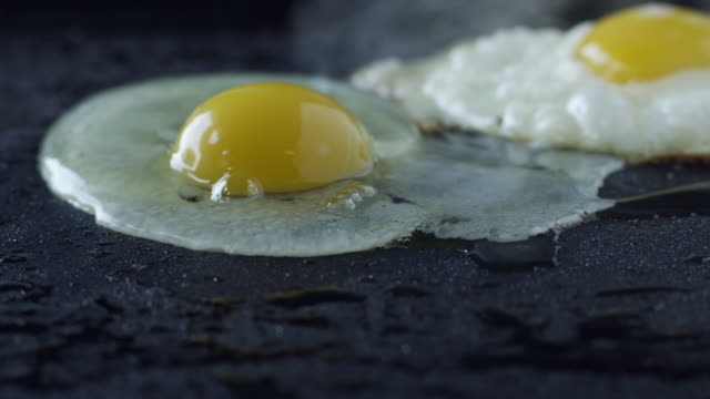 stockvideo's en b-roll-footage met cu two eggs on frying pan / orem, utah, usa - orem utah