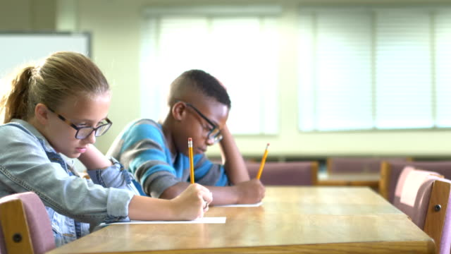 two elementary school students taking a test - 10 11 years stock videos & royalty-free footage