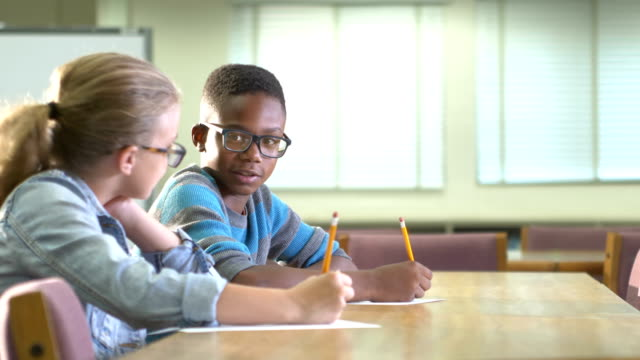 two elementary school students writing, talking - 10 11 years stock videos & royalty-free footage