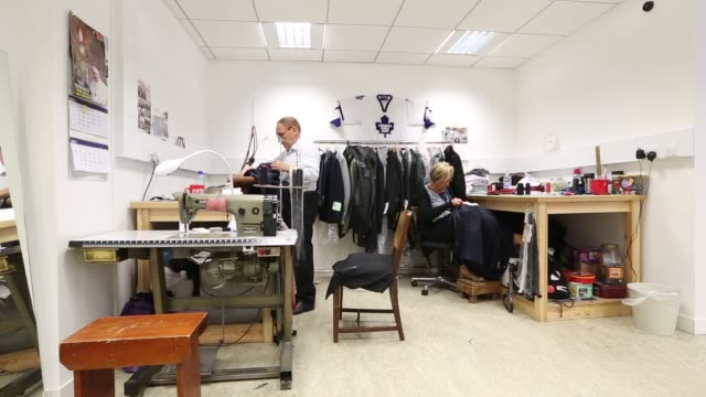 two employees work on the manufacture of suits in the workshop of the tailors dege skinner based on savile row in london an employee works with... - savile row stock videos and b-roll footage