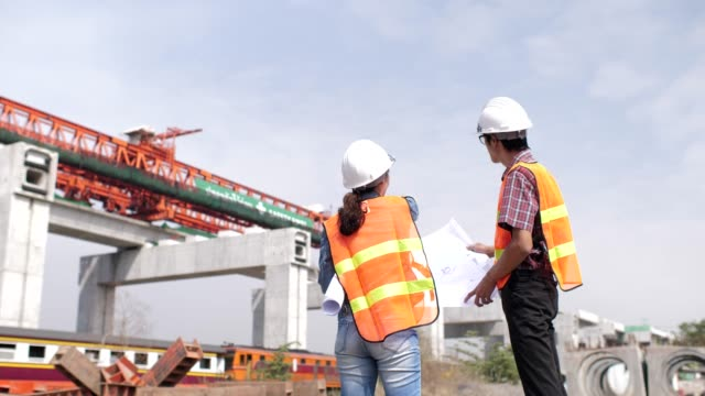 Two Engineer talking in Construction site