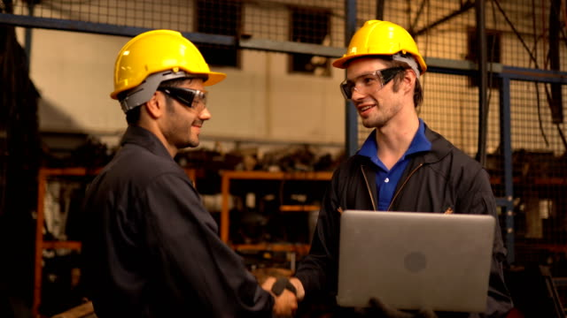 two engineering in production plant as team discussing - manufacturing machinery stock videos & royalty-free footage
