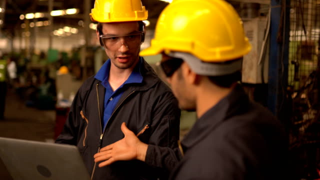 two engineering in production plant as team discussing - mechanic stock videos & royalty-free footage