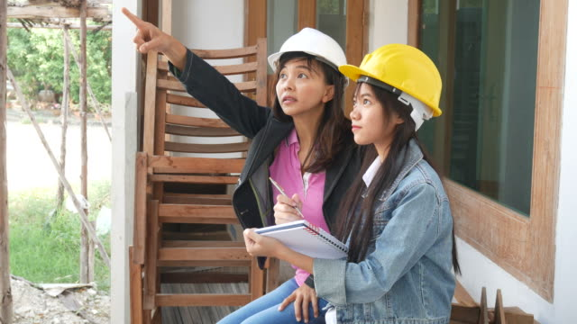 two engineers woman at construction site - timber stock videos and b-roll footage