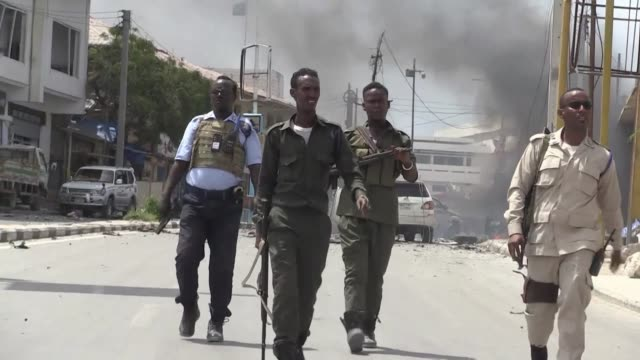 two explosions rocked somalia's internal security ministry in the capital mogadishu killing five civilians in the latest attack claimed by shabaab... - corno d'africa video stock e b–roll