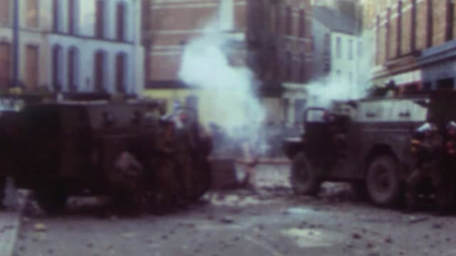two exsoldiers face charges over alleged 'murder' of ira man file 3011972 derry / londonderry ext bloody sunday british troops firing tear gas at... - 1972 stock videos & royalty-free footage