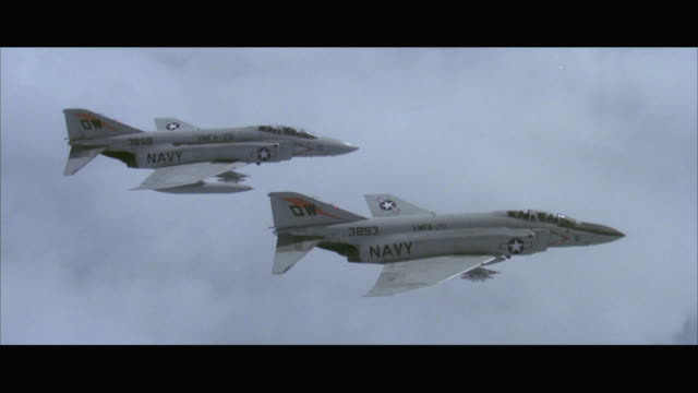 ws ts two f-4 navy grey phantom military jet airplanes flying side by side - 1978 stock videos and b-roll footage