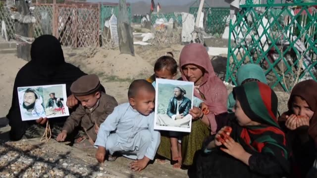 two families of suicide attack victims in afghanistan wish for peace after losing their sons and fathers to suicide attacks leaving over a dozen... - violence stock videos & royalty-free footage
