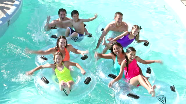 two families on lazy river at water park - 30 39 years stock videos & royalty-free footage