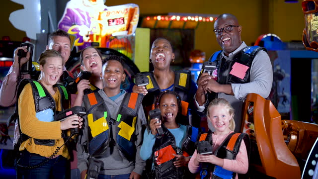 two families ready to play laser tag - 14 15 years stock videos & royalty-free footage