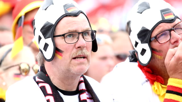 two fans are getting upset and are looking disappointed during germany lost the 2018 fifa world cup russia group f match against korea republic at... - fifa world cup 2018 stock videos & royalty-free footage