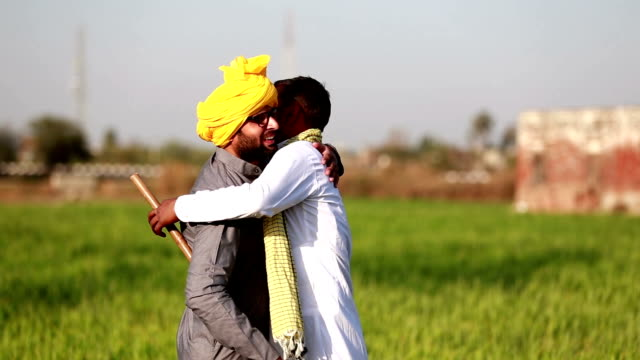 two farmer hugging portrait - turban stock videos & royalty-free footage
