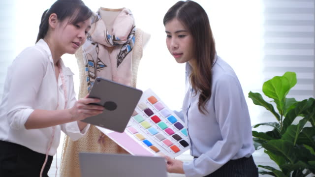 two fashion designers working at small business at home - designer clothing stock videos & royalty-free footage