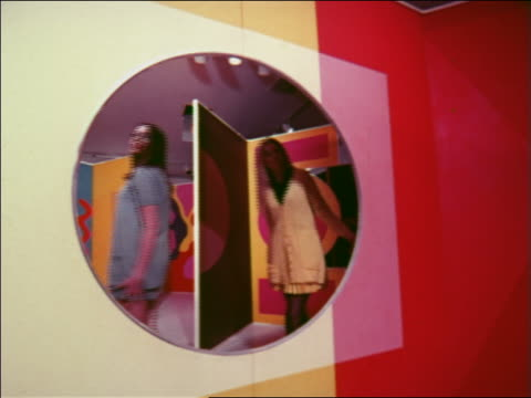 1970 two fashion models in skirts looking thru art exhibit in museum / atlanta / travelogue - minigonna video stock e b–roll