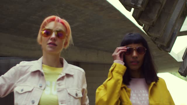 two fashionable women walking in an abandoned building - offbeat stock videos & royalty-free footage