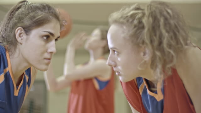 two female basketball players standing face to face - staring stock videos & royalty-free footage