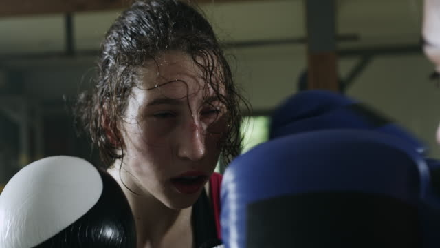 two female boxers boxing in the boxing ring - punching stock videos and b-roll footage