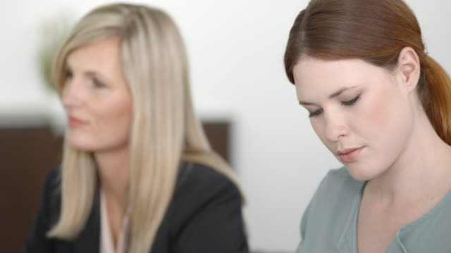 two female colleagues at a meeting with their coworkers - employee engagement stock videos & royalty-free footage