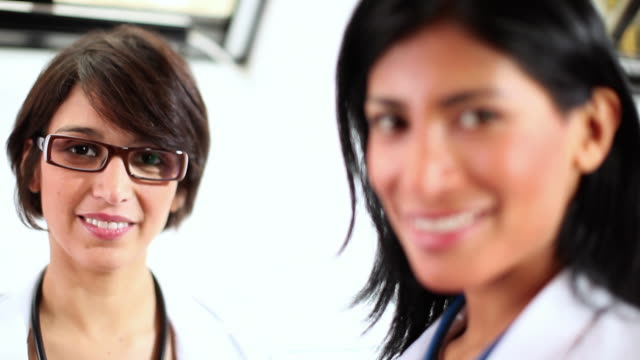 CU R/F Two female doctors looking at camera / Brussels, Belgium