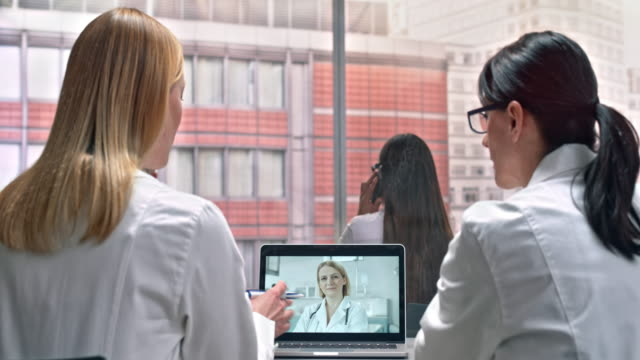 DS Two female doctors on a video call with their laboratory colleague
