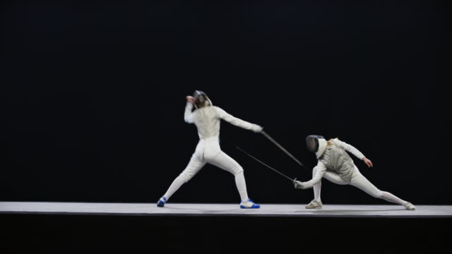 ld two female fencers attacking each other on the piste - sword stock videos & royalty-free footage