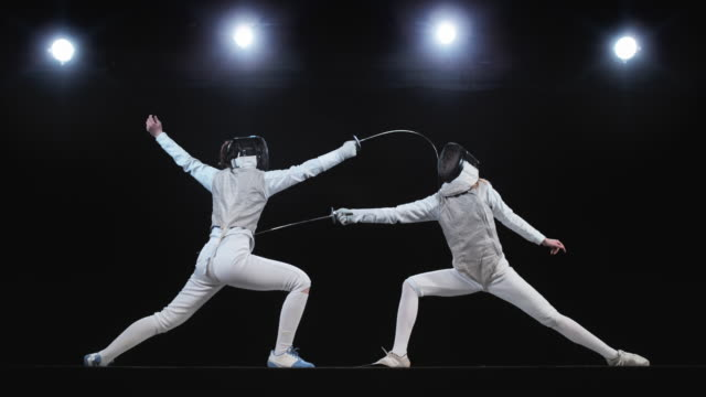 slo mo ld two female fencers attacking with a lunge - standing stock videos & royalty-free footage