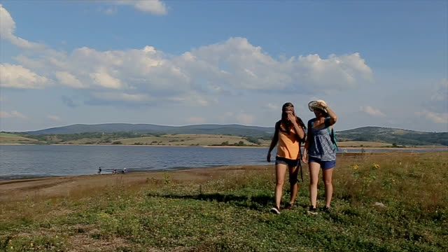 two female friends exploring nature - cinemanis videography stock videos & royalty-free footage
