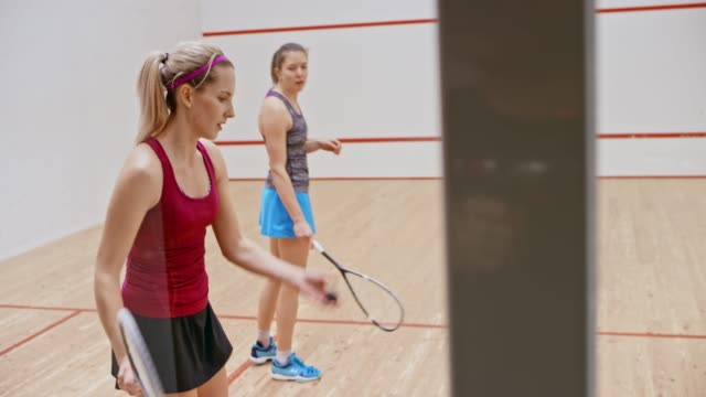 two female friends playing squash - squash sport stock videos & royalty-free footage