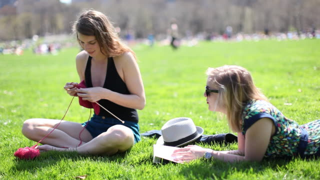 MS Two female friends relaxing and talking on central park / New York City, New York, United States