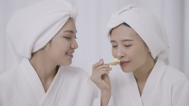 two female friends smelling spa salt - medium group of objects stock videos & royalty-free footage