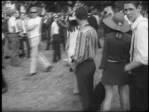 two female hippies in big hats walking thru crowd at be-in / london - 1967 stock videos & royalty-free footage