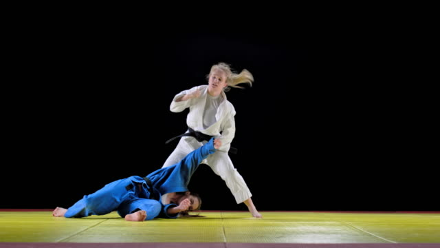 two female judo contestants in a fight - world sports championship stock videos & royalty-free footage