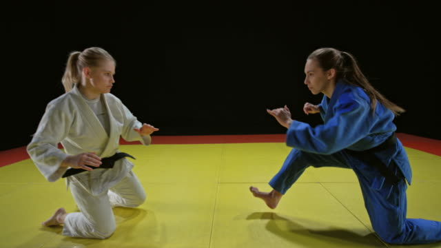 slo mo two female judoists starting the fight after the sitting bow - world sports championship stock videos & royalty-free footage