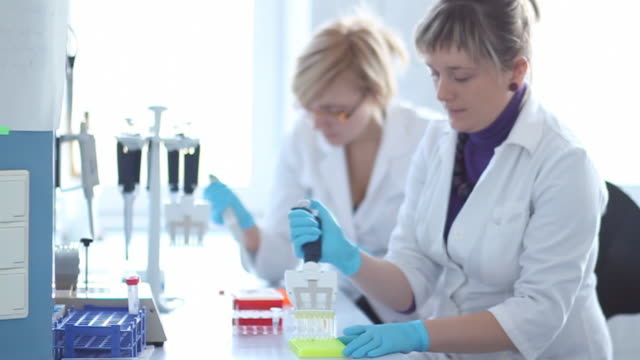 two females in laboratory HD slow motion
