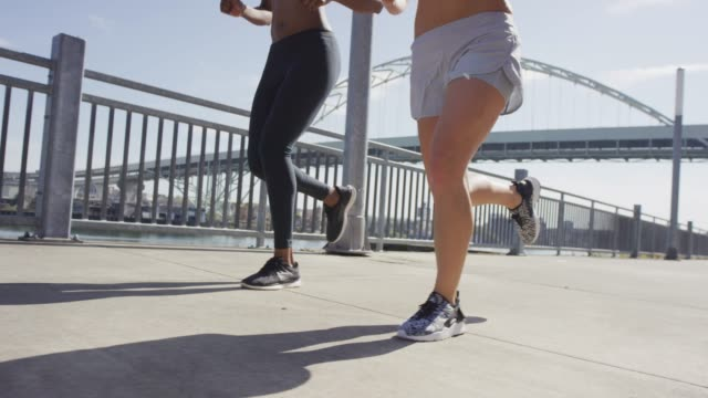 two females running on a sunny day - emergency equipment stock videos & royalty-free footage