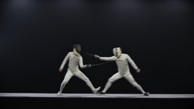 ld two fencers striking at each other and fencer on the left wins a point in a bout - defeat stock videos & royalty-free footage