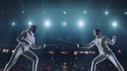 Two fencing sportswomen on professional arena