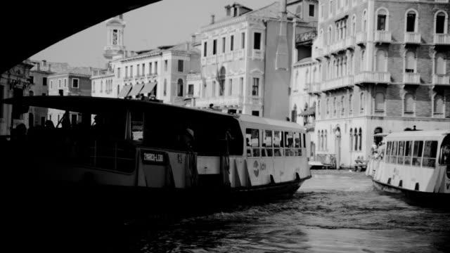 two ferries under the rialto bridge - traghetto video stock e b–roll