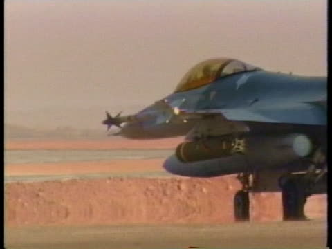 two fighter jets taxi down an airfield runway in iraq. - iraq stock videos & royalty-free footage
