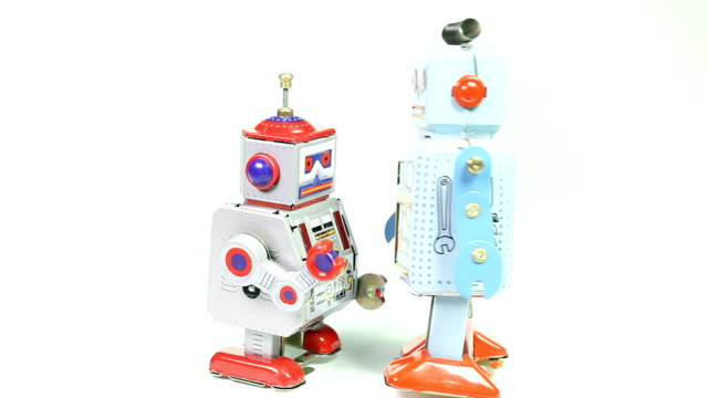 Two fighting retro tin toy robots