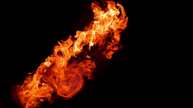 slo mo two fireballs colliding on black background - fireball stock videos & royalty-free footage