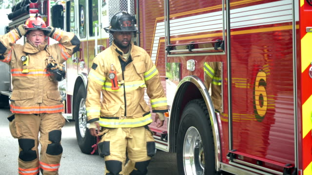 two firefighters ready for action - fire protection suit stock videos & royalty-free footage