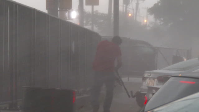 two fishermen are caught in a sudden torrential downpour near jamaica bay during a severe thunderstorm in howard beach queens new york new york - scott mcpartland stock videos & royalty-free footage