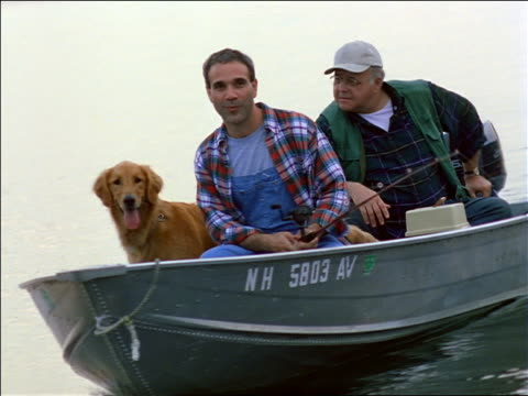 two fishermen fishing from boat on lake / golden retriever dog in boat - fully unbuttoned stock videos & royalty-free footage