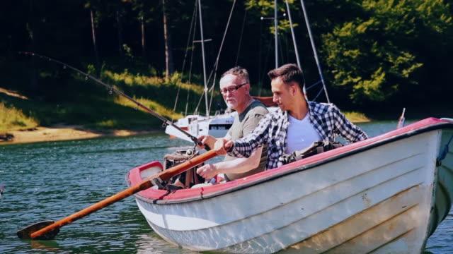 vídeos de stock, filmes e b-roll de two fishermen/ polanczyk/ poland - fishing