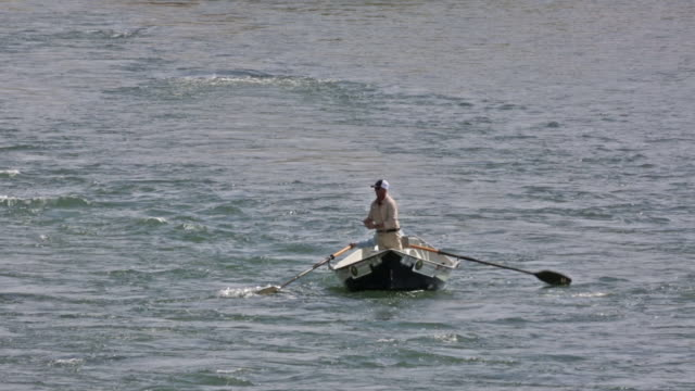 two fly fishermen float and fish from a drift boat on the snake river in idaho - snake river stock videos & royalty-free footage