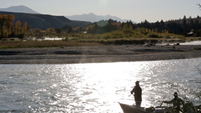 two fly fishermen float and fish from a drift boat on the snake river in idaho - river snake stock videos & royalty-free footage